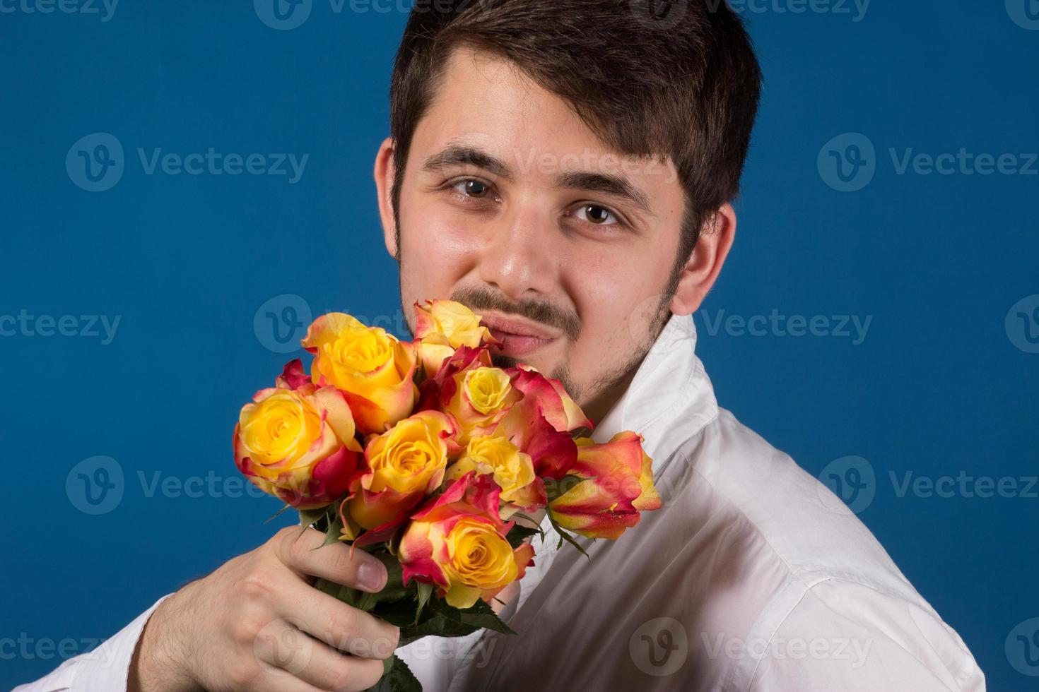 Man with bouquet of red roses photo
