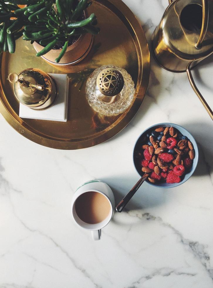 Bowl of cereal beside coffee photo
