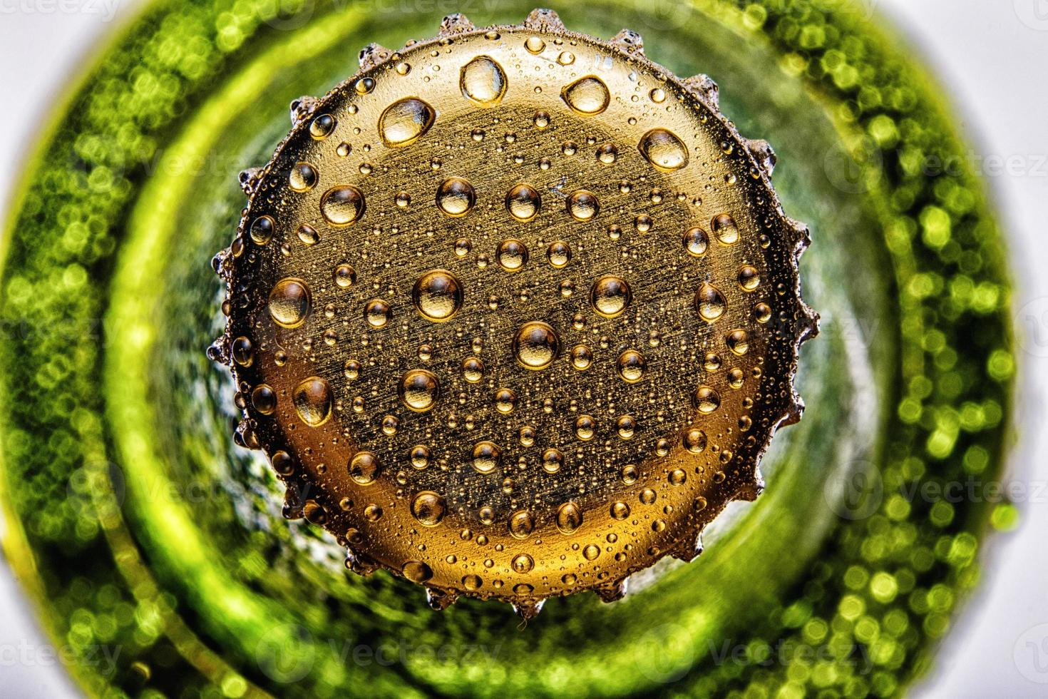 Top of the green beer bottle closeup photo