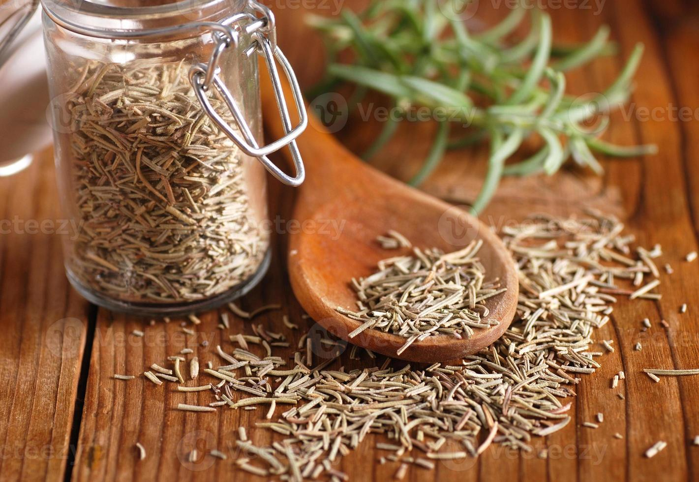 dried rosemary on the spoon photo