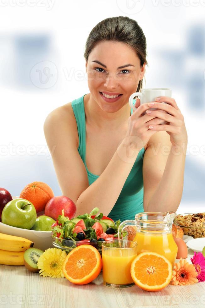 Young woman having breakfast. Balanced diet photo