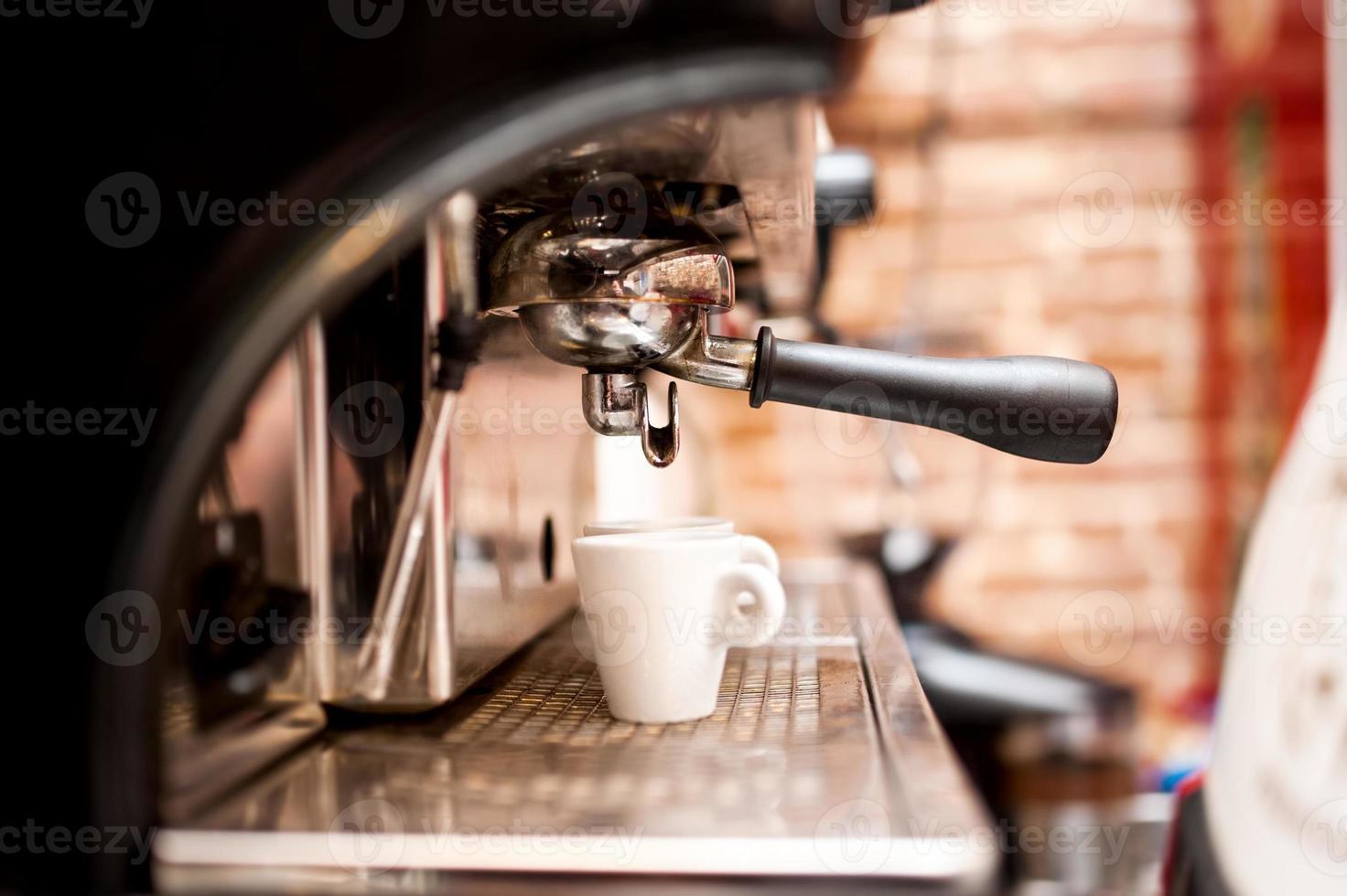 machine preparing espresso in coffee shop or bar photo