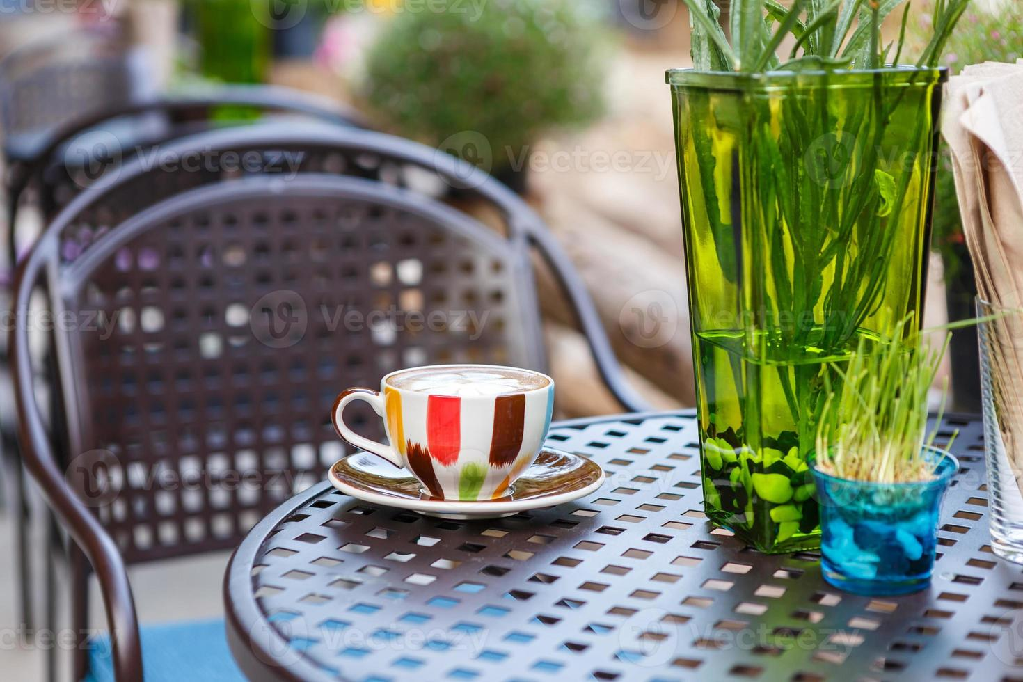 Coffee cup on table in cafe photo