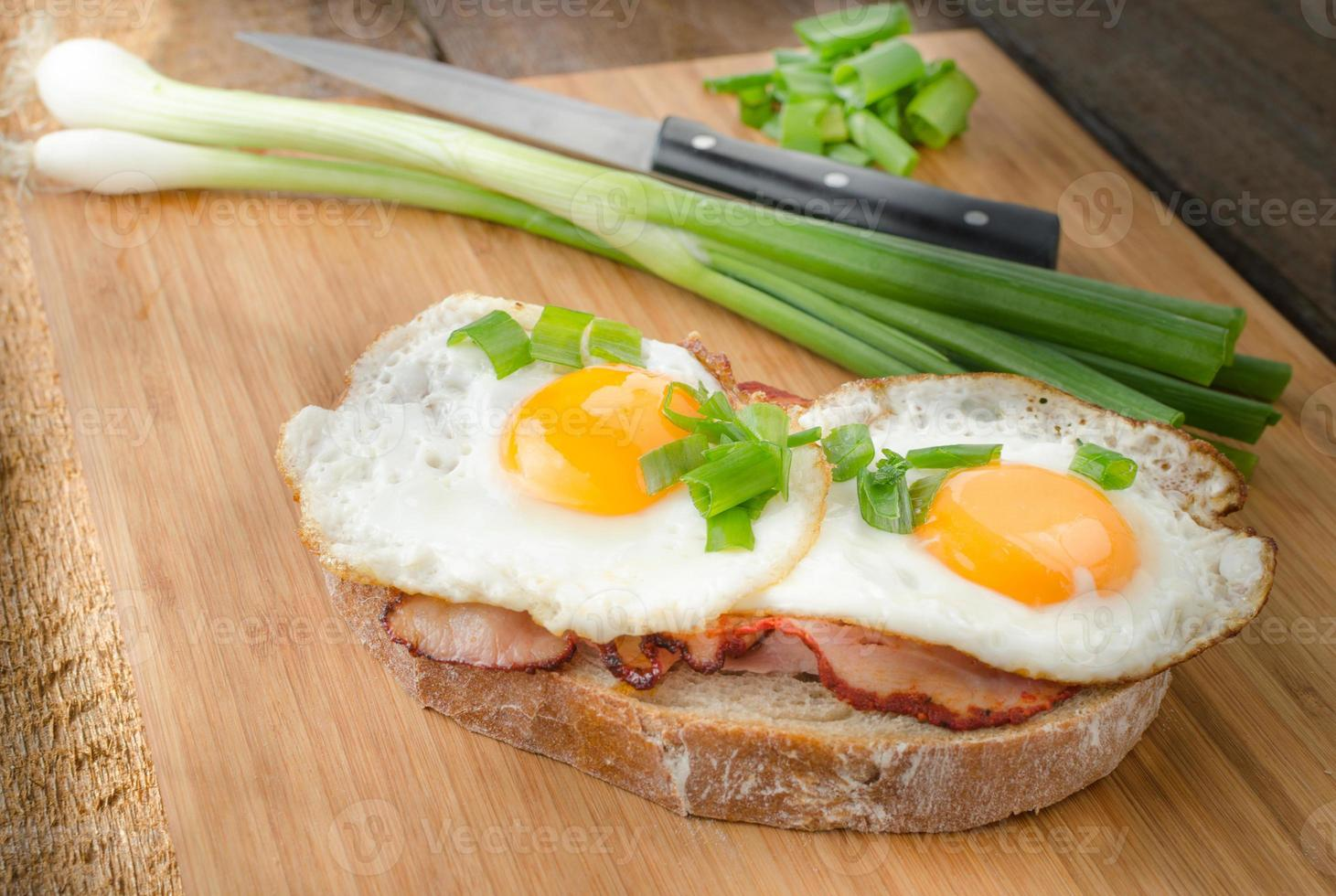 Fresh bread with eggs and ham photo