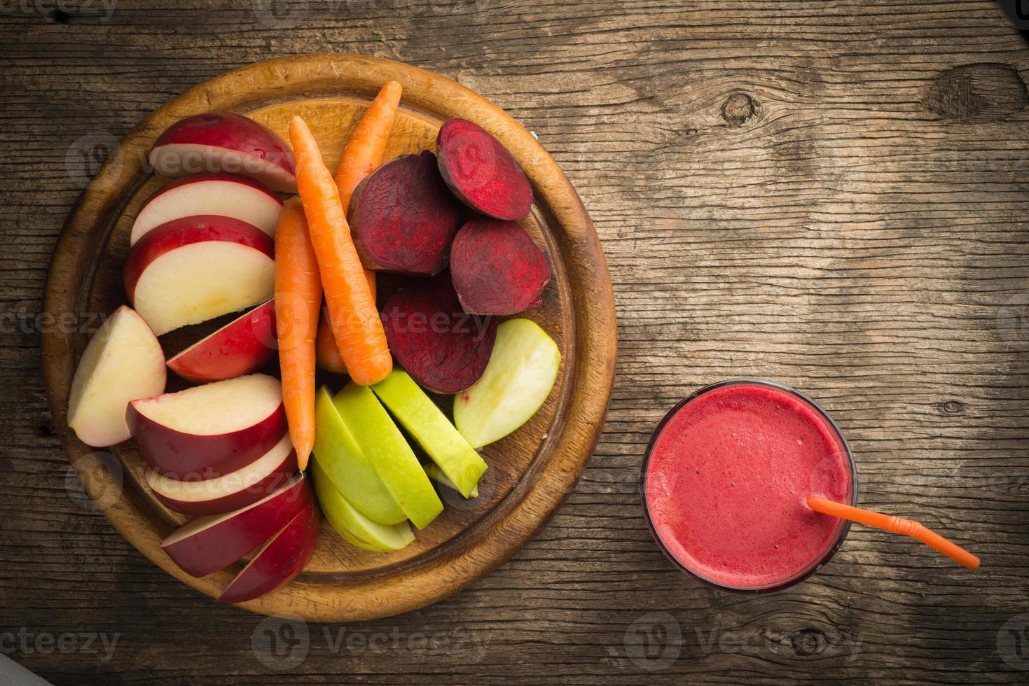 Glass of fresh beetroot, apple and carrot juice photo