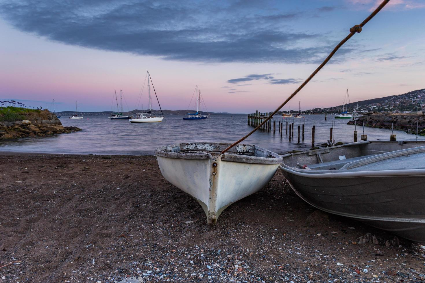 Boats on sand and in water photo