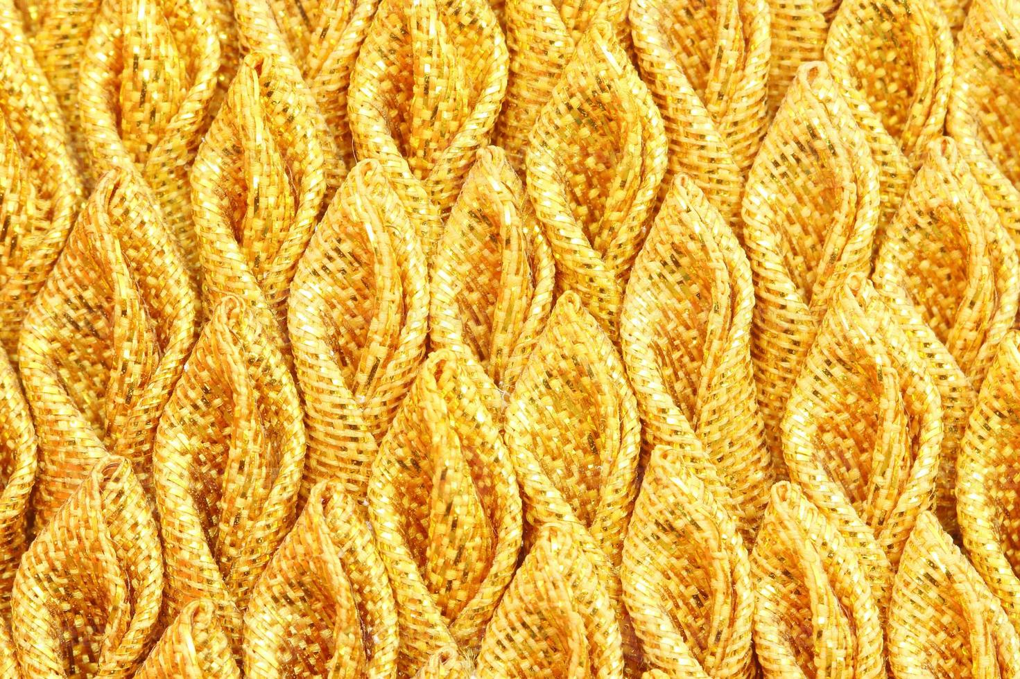 gold pleated fabric silk for background photo