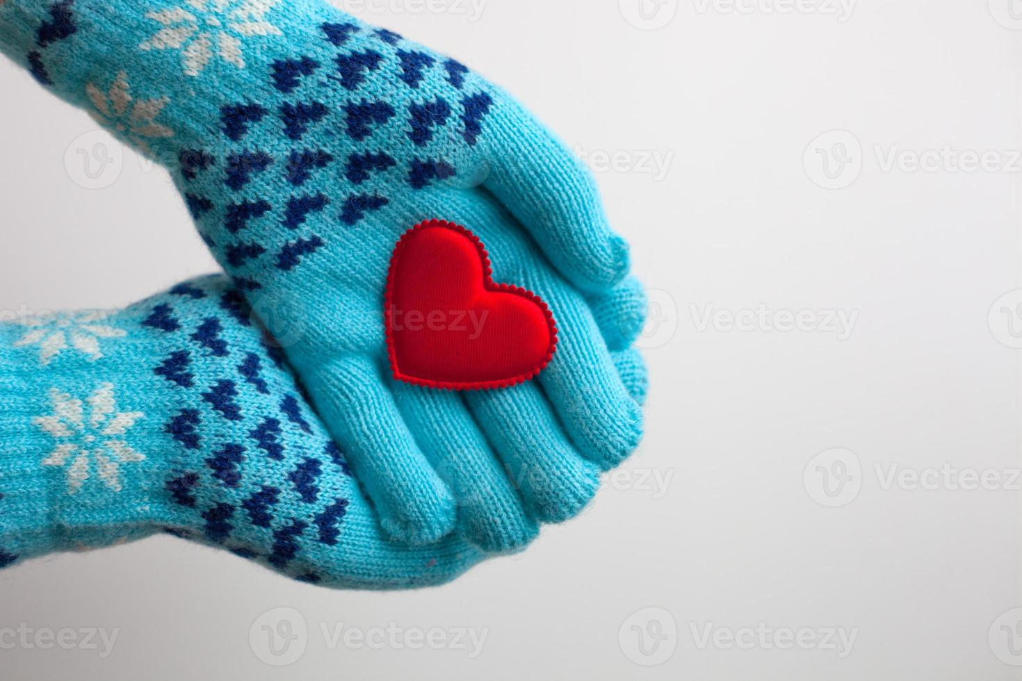 Red heart in hands in  warm  gloves for Valentine's Day photo