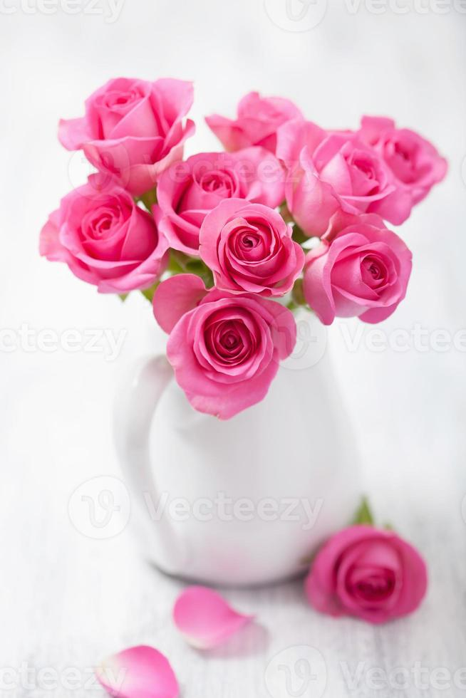 beautiful pink roses bouquet in vase photo