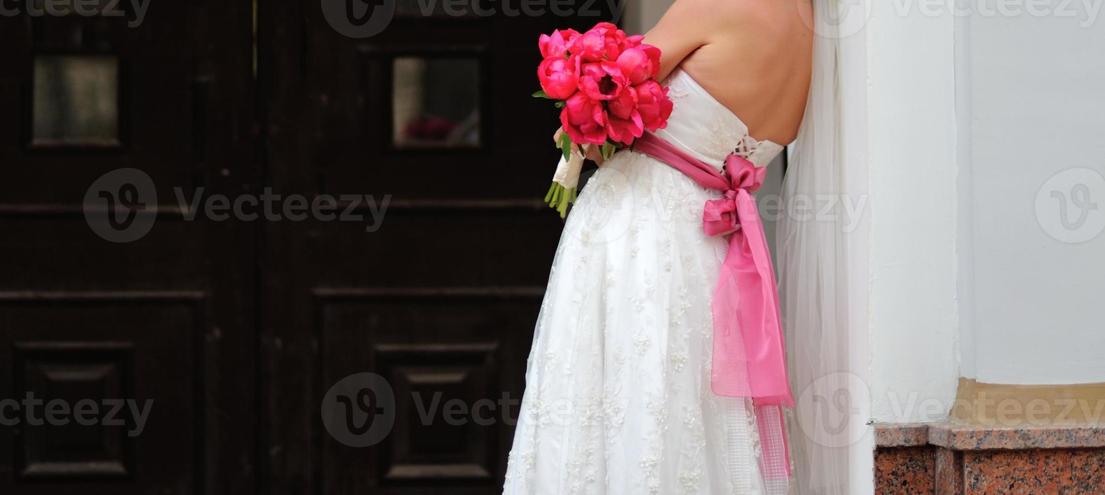 Gorgeous bride in beautiful dress. photo