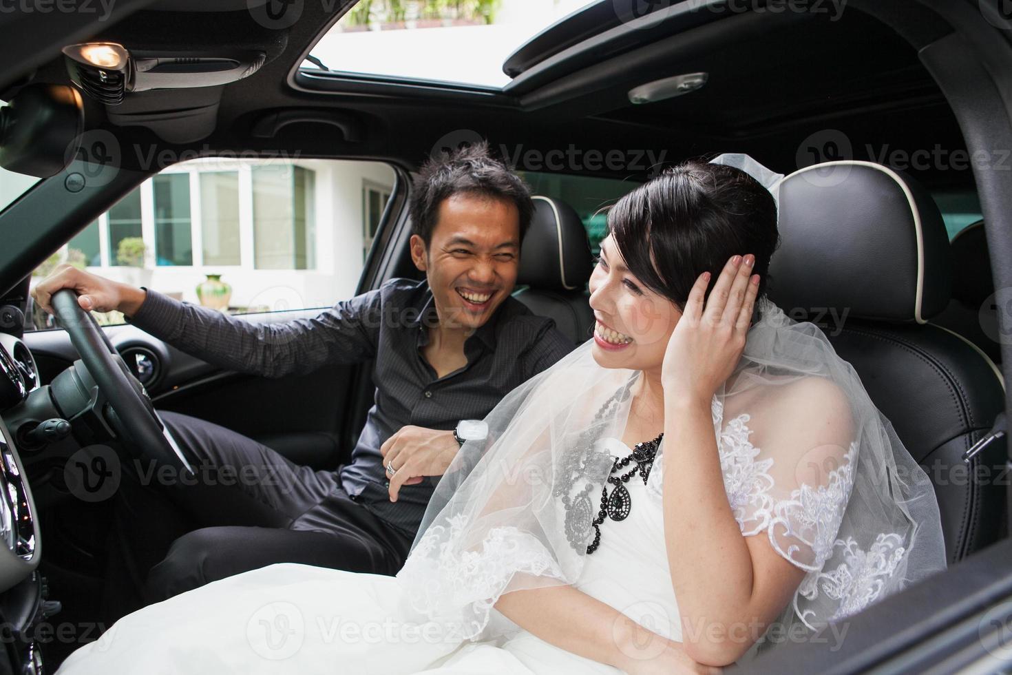 gorgeous wedding couple in car photo