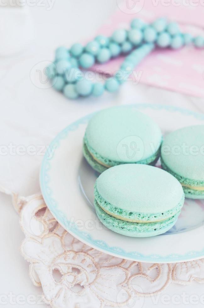 Pastel mint macaroon on light background photo