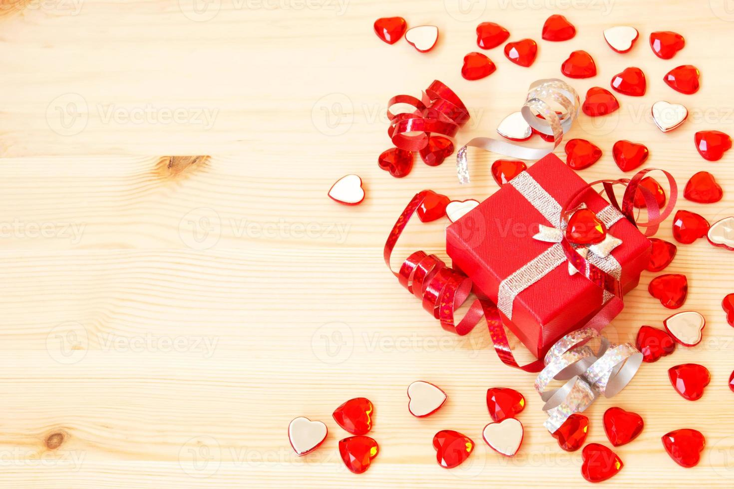 cute red gift box, ribbons and valentine's hearts photo