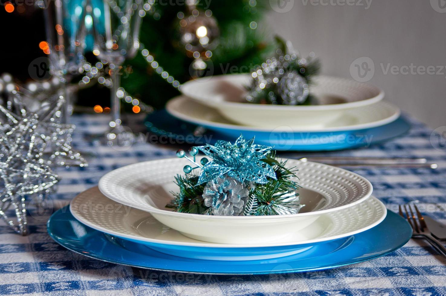 table set for christmas dinner with decoration blue and silver photo