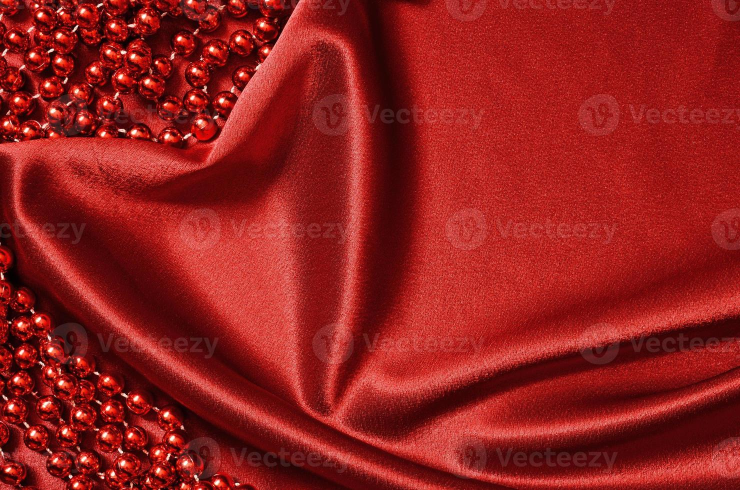 Red satin drapery and beads photo