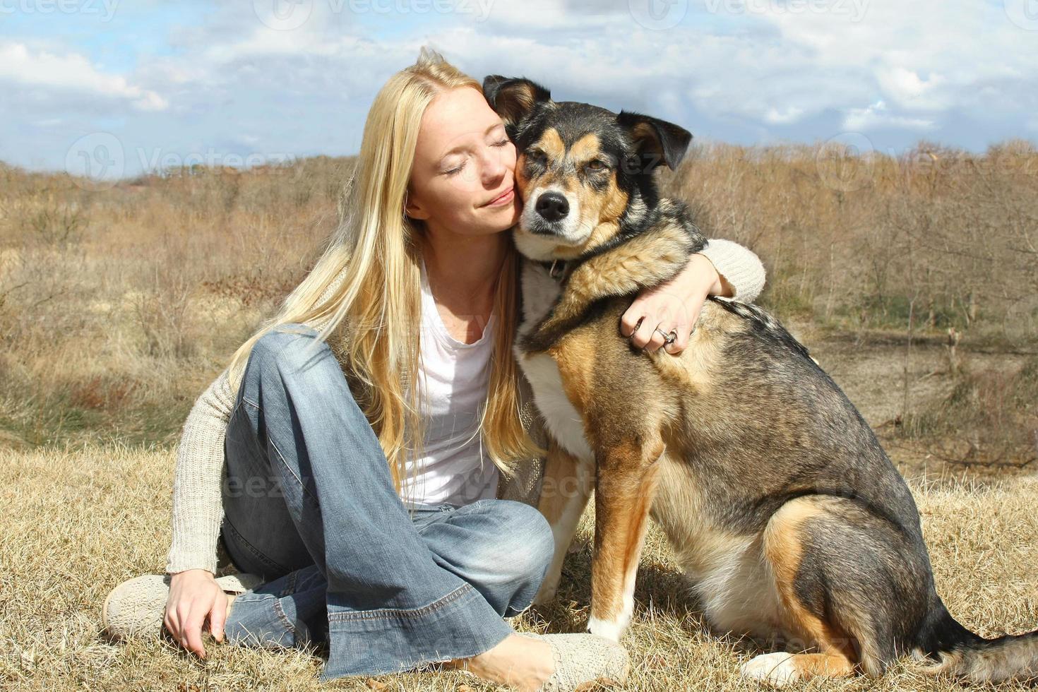 Woman Hugging German Shepherd Dog Outside photo
