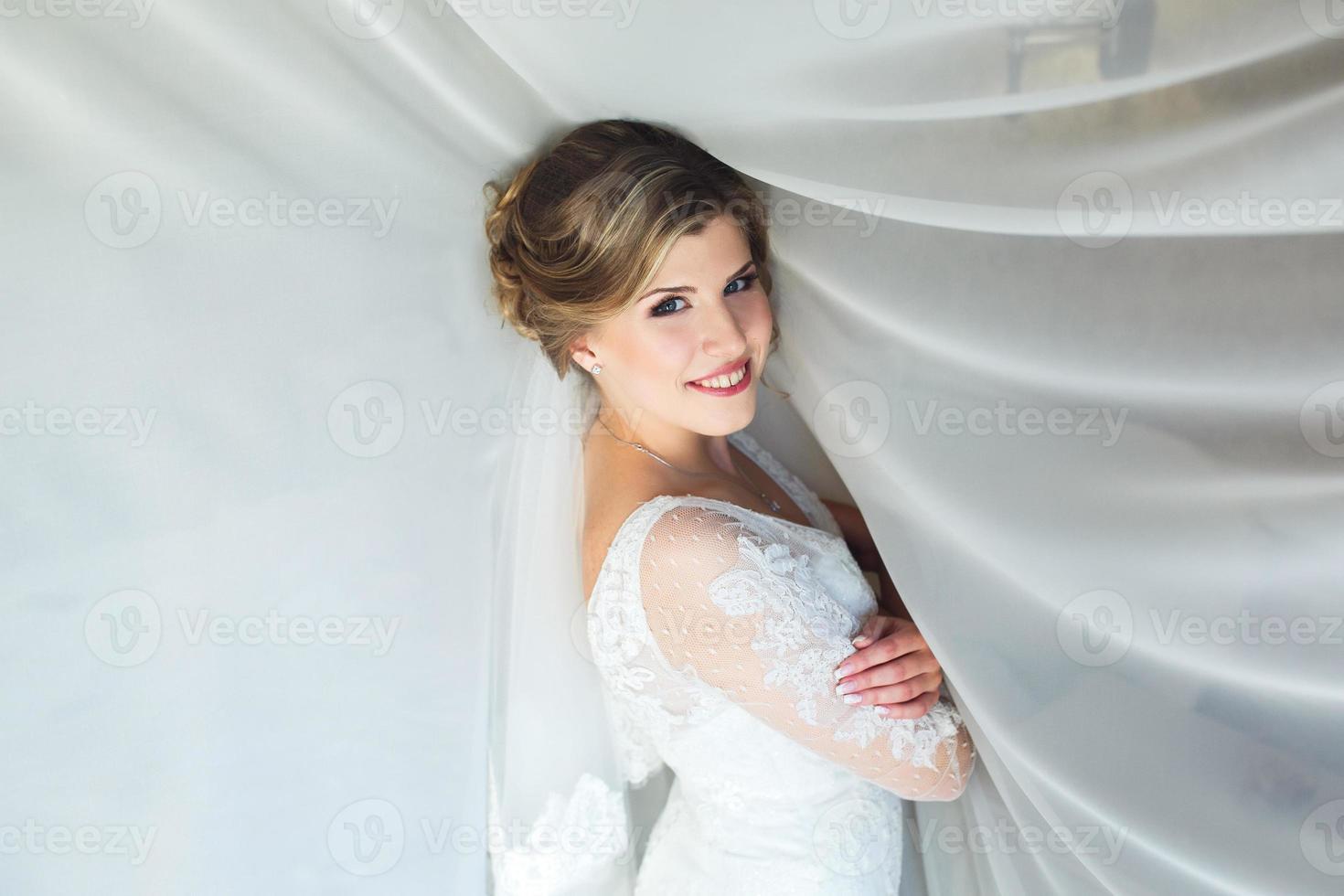 Bride posing in a hotel room photo