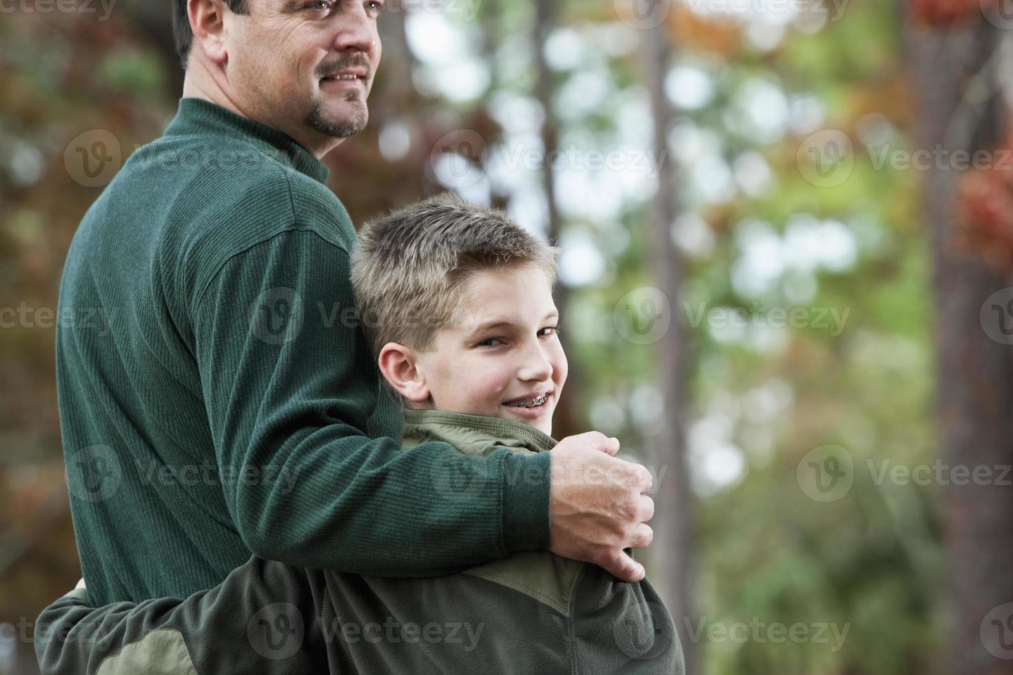 Rear view of father and son at park photo