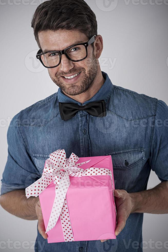 Fashion hipster with pink gift photo