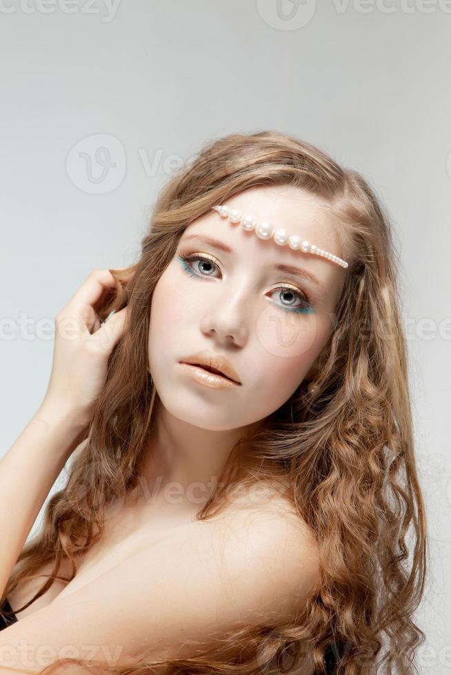 Beautiful woman with pearl-beads photo