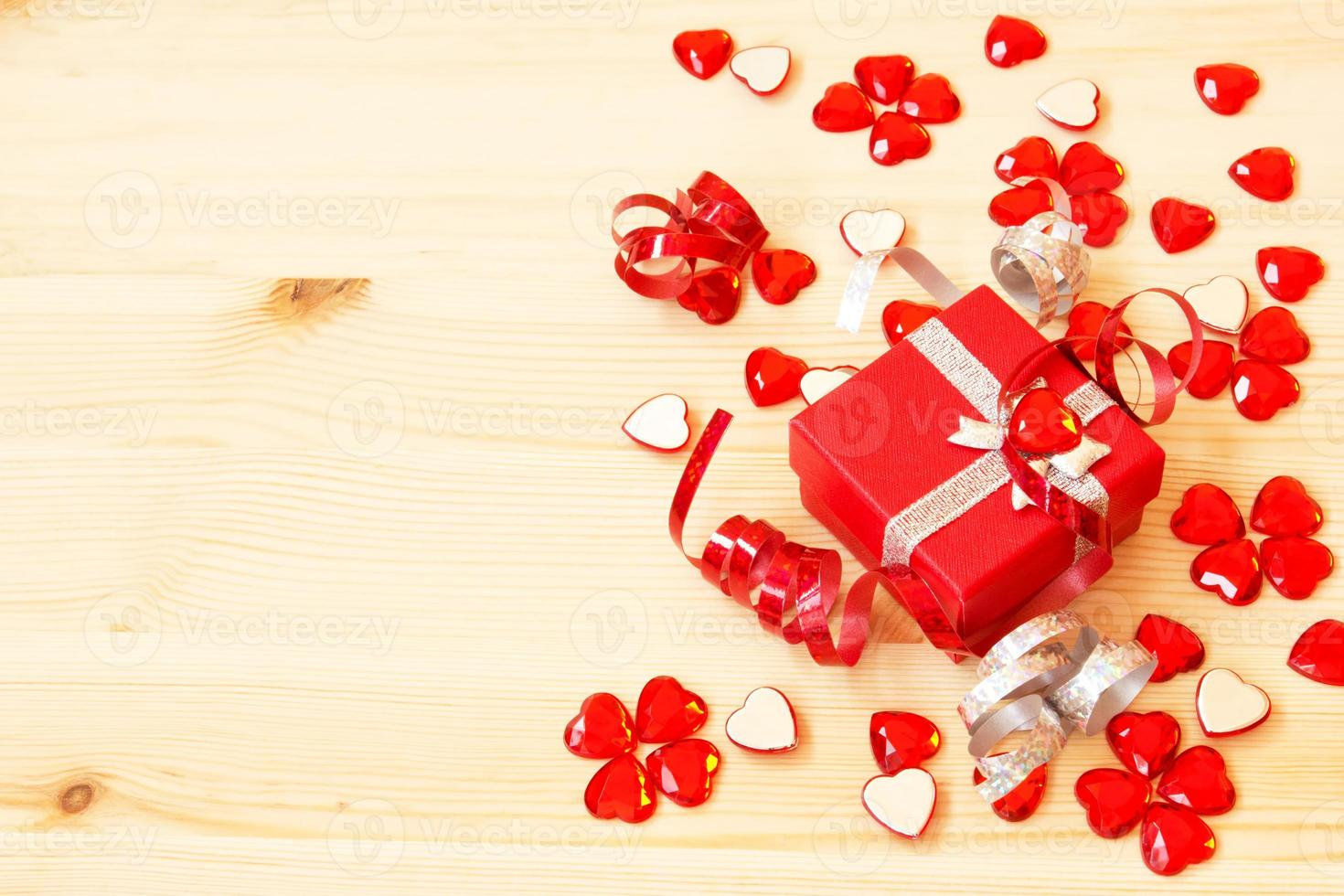 red gift box, ribbons and valentine's hearts photo