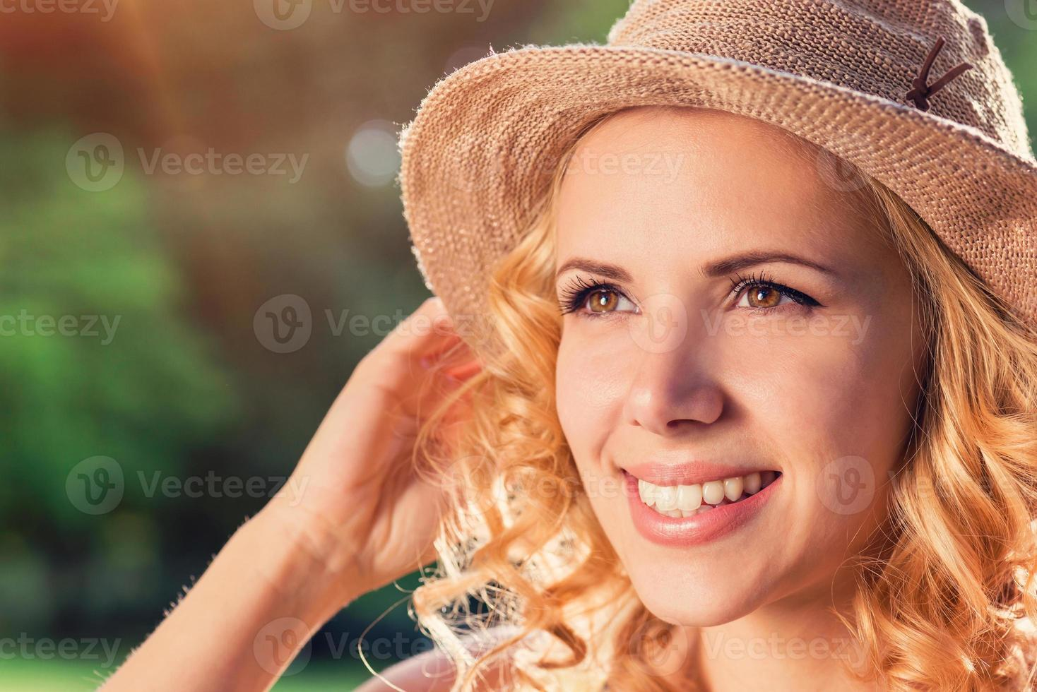 Beautiful woman in summer nature photo