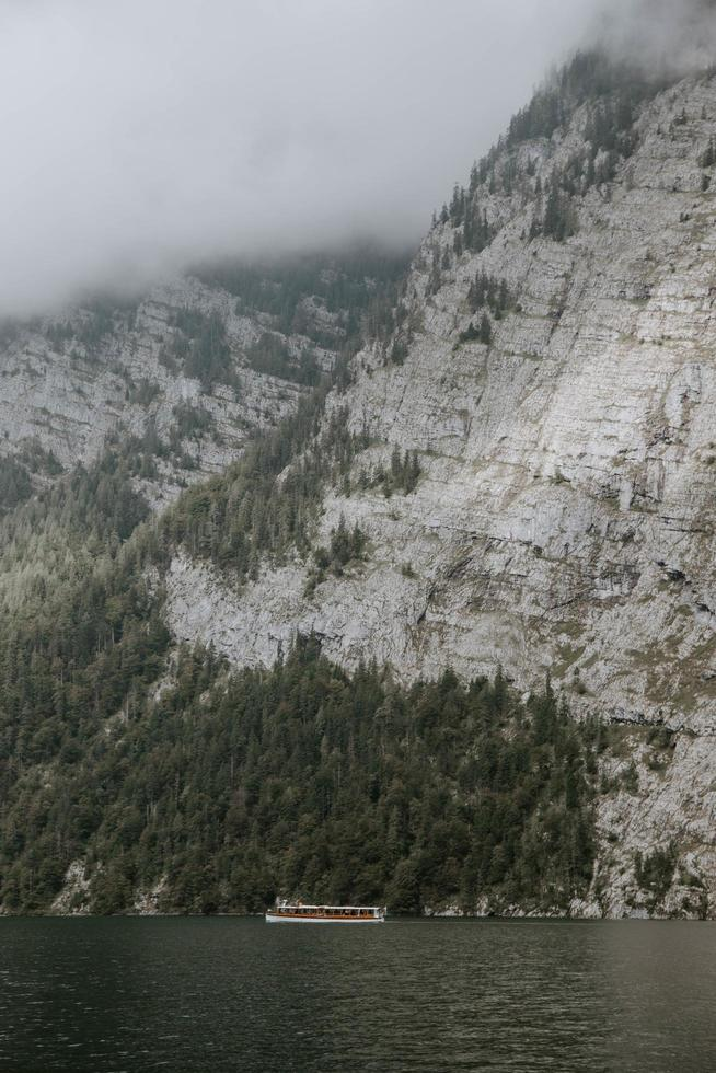 Rocky mountains near body of water photo