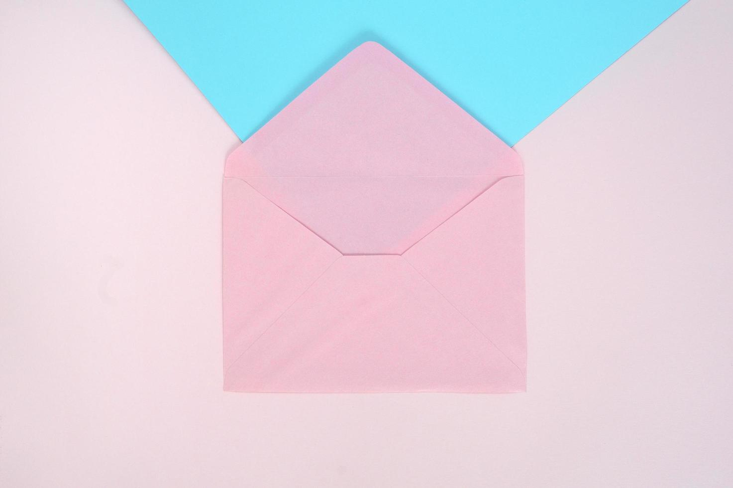 Pink envelope on pink and blue background photo