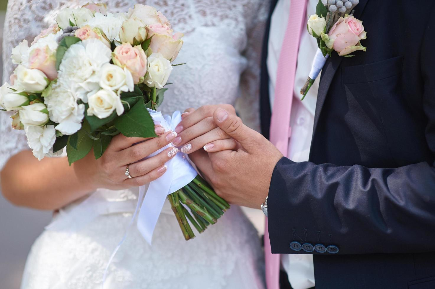 Groom holds his bride's hand  photo