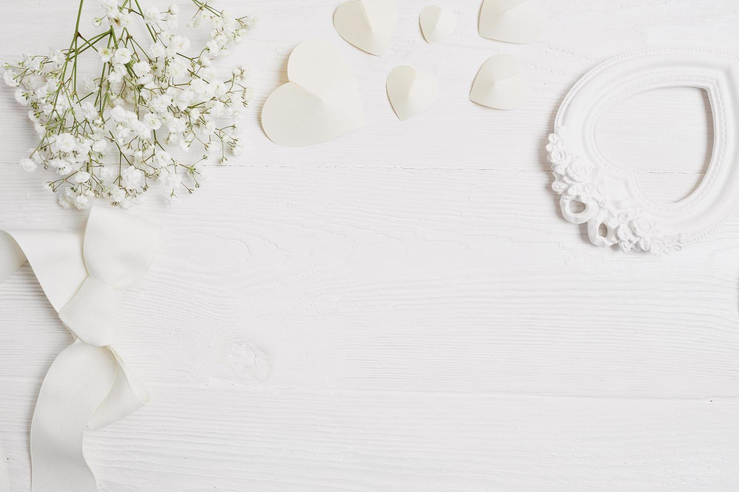 Mockup background with flowers and paper hearts photo