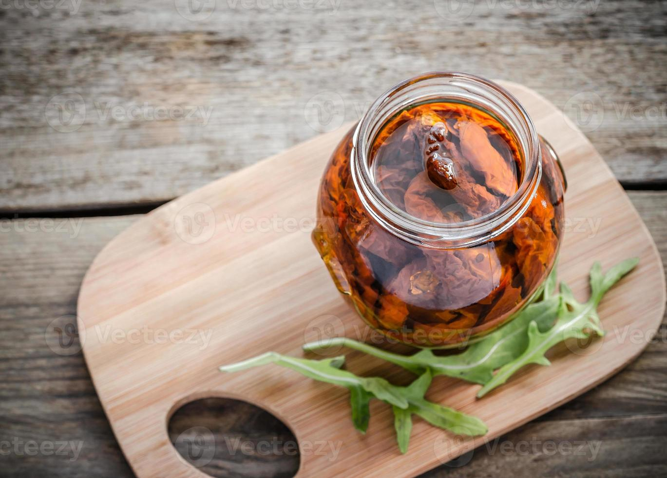 Sun dried tomatoes in olive oil photo
