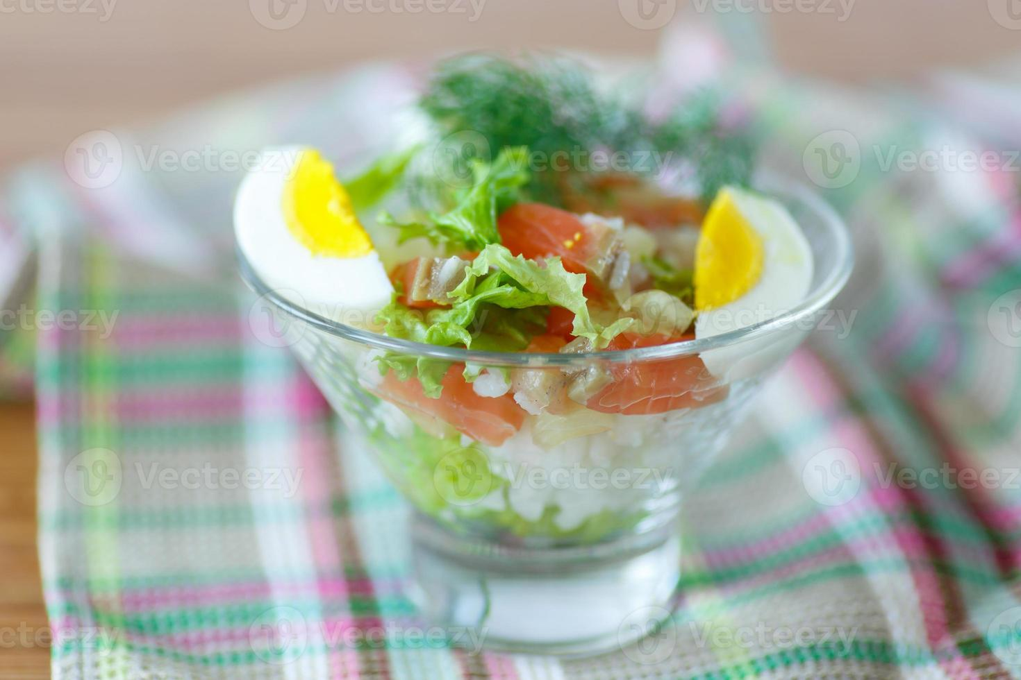 salad with salmon and rice  vegetables photo