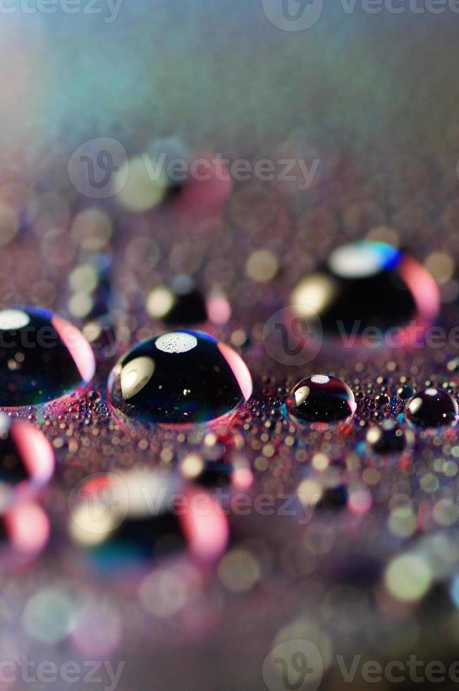Macro of Water drops on a DVD surface photo