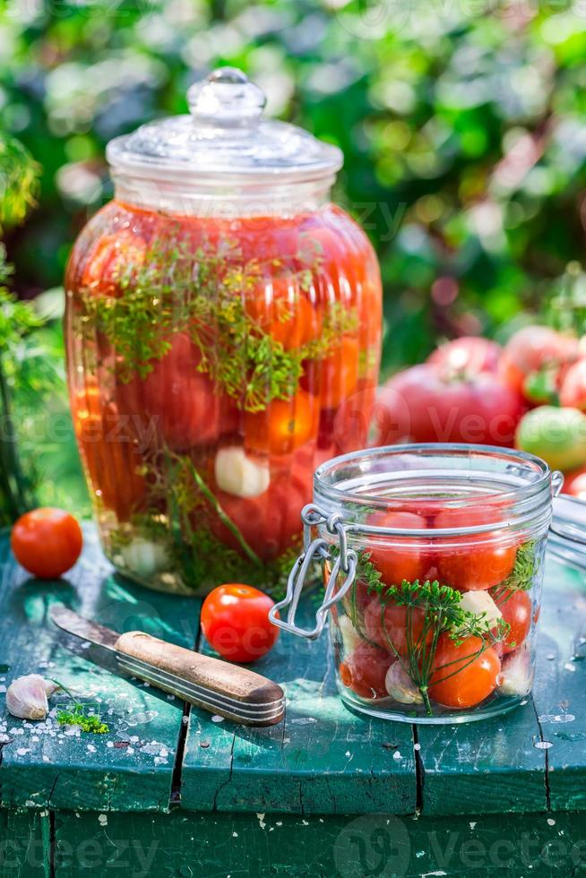 Preparation for pickled tomatoes in the jar photo