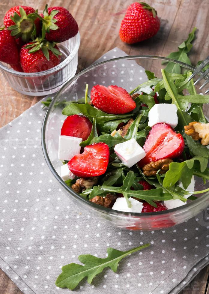Healthy salad on the wooden table photo
