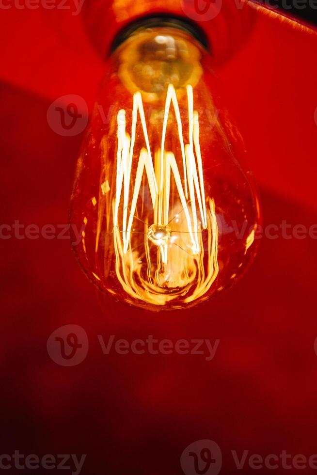 Red light bulb glowing photo
