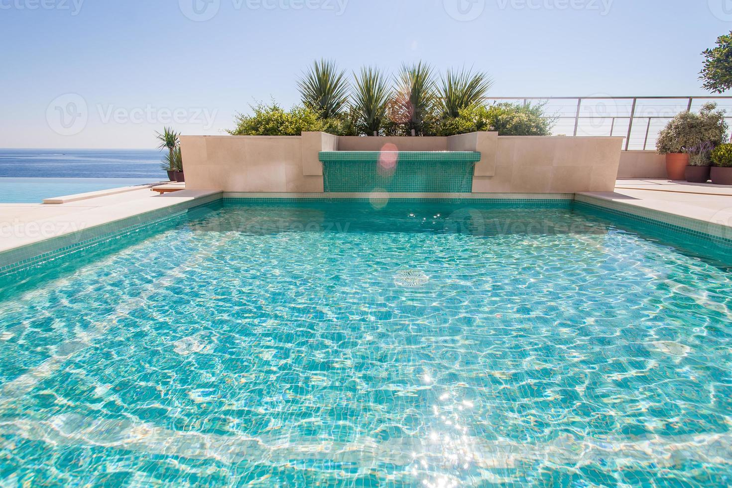 Luxury swimming pool and blue water photo
