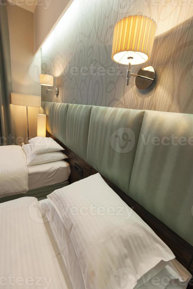 Two beds hotel room detail photo