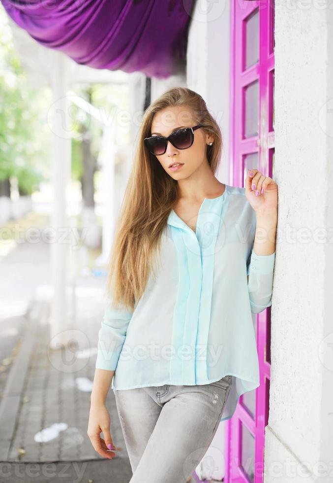 portrait young girl wearing a sunglasses and shirt photo