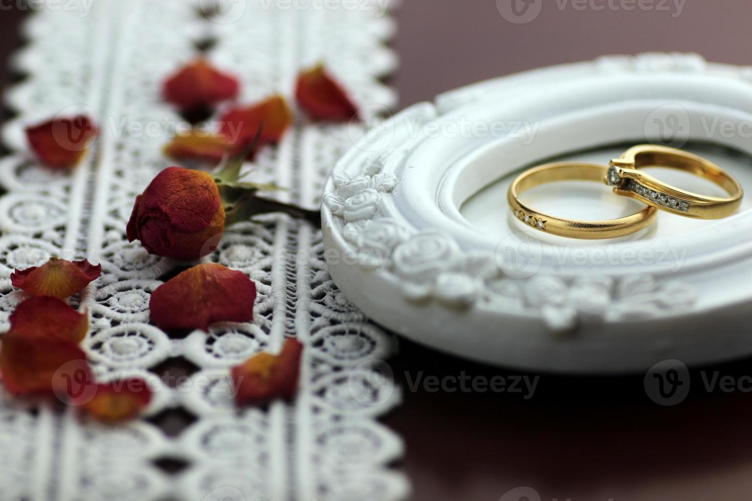 lace wedding rings petals photo