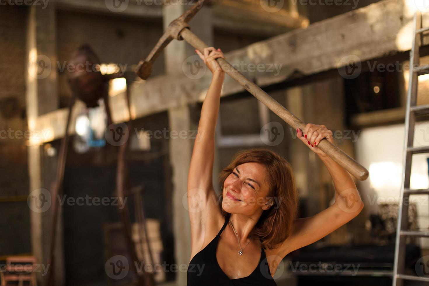 beautiful young woman posing with pickax photo