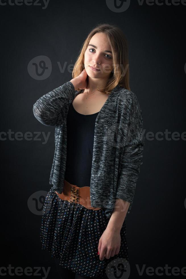 Beautiful woman doing different expressions in different sets of clothes photo
