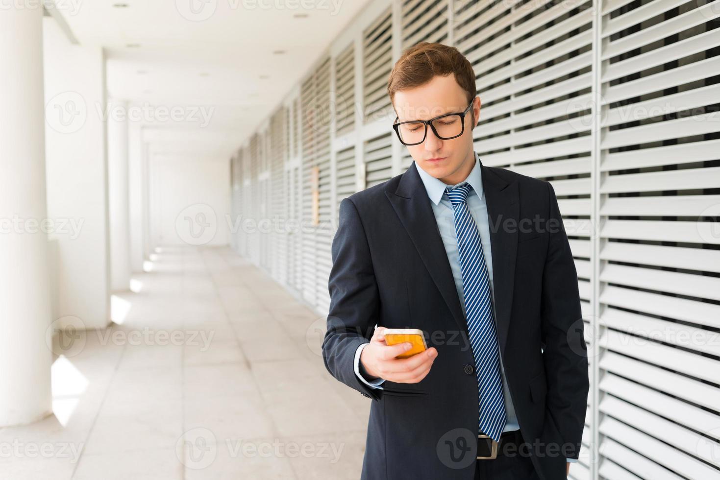 Texting businessman photo