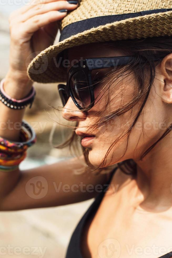 young summer girl wearing a hat  and sunglasses photo