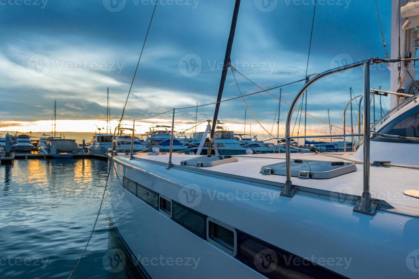 Empty catamaran yacht deck sailing on the sea photo