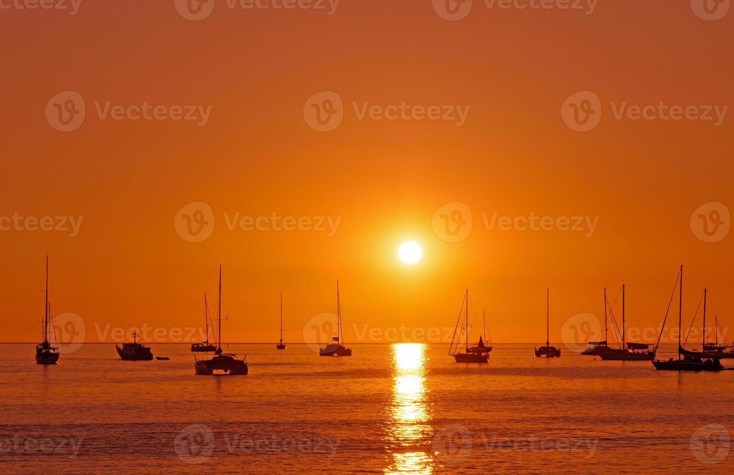 Sunset with boat at phuket, Thailand photo