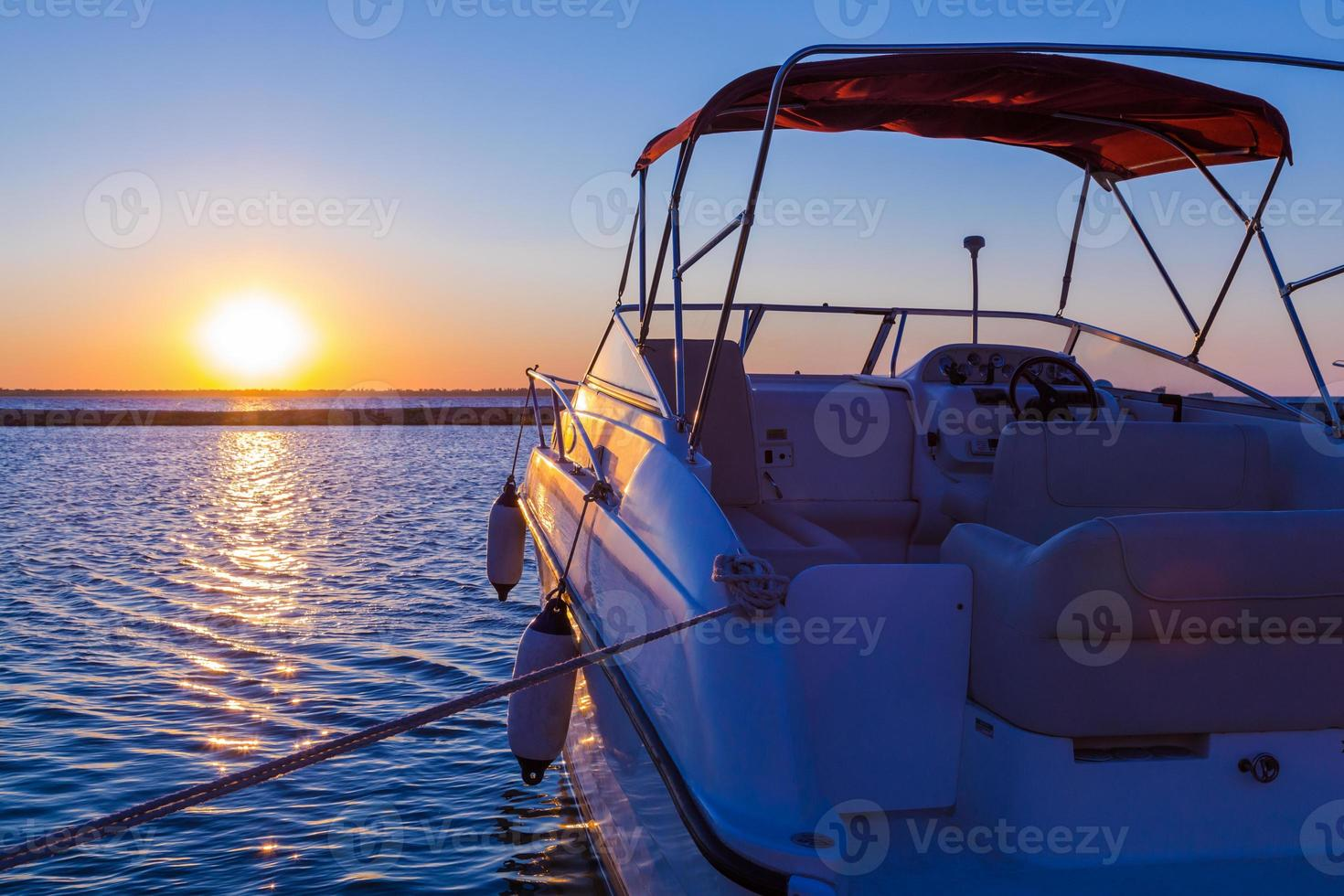 Yacht near the pier against sunset photo