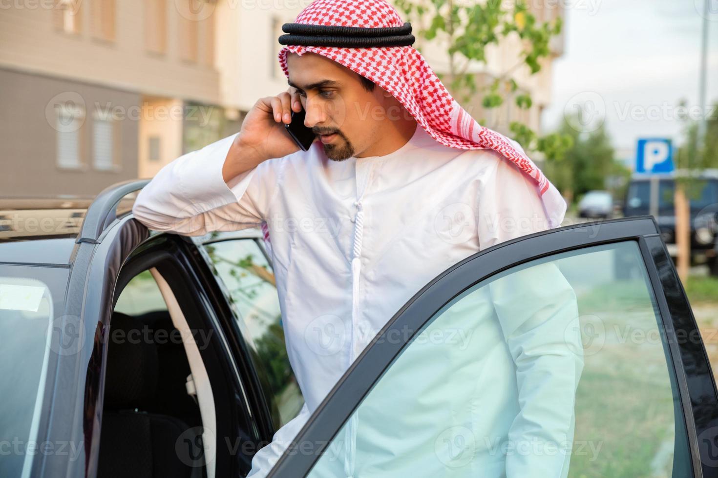 Young Arabian Next To Car photo