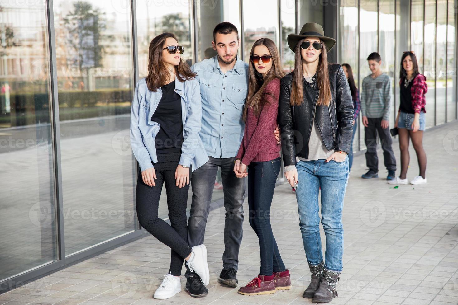 Group of happy teenage friends having fun photo