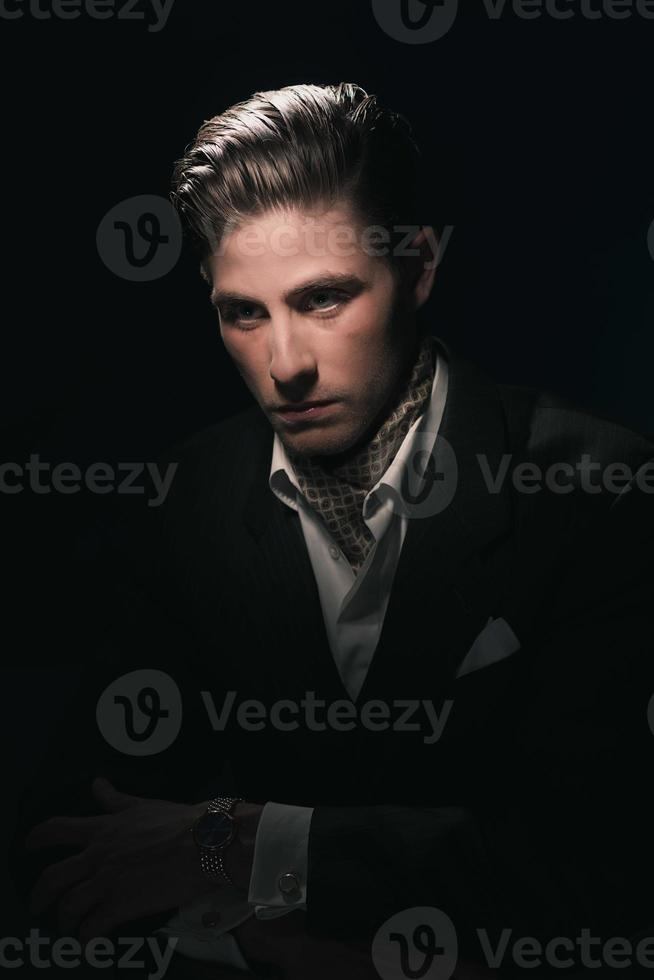 Stylish Vintage fashion dandy young man with scarf in suit. photo